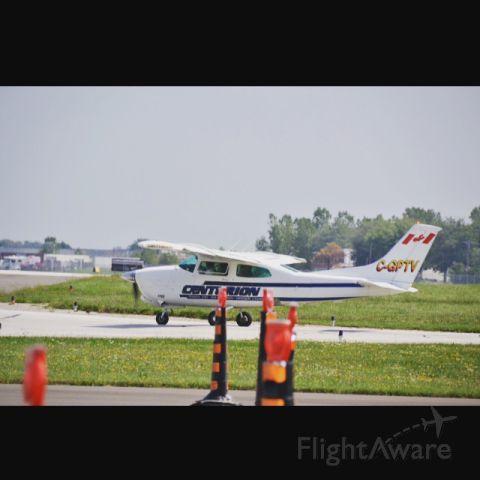 "Cessna Centurion (C-GPTV) - A Cessna 210 taxing at ""Windsor International Airport""."