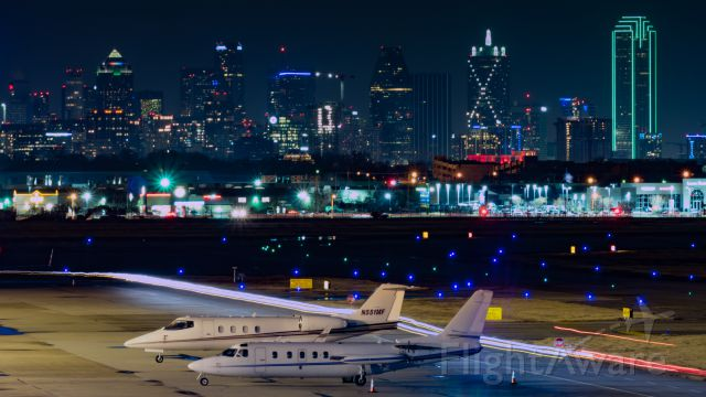 Learjet 55 (N551MF) - Jet Aviation ramp with downtown Dallas in the background