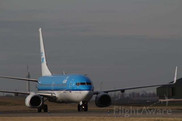 Boeing 737-700 (PH-BXG) - Boeing 737-800 KLM landed on the new runway and taxiing to the terminal at Schiphol Amsterdam Airport.