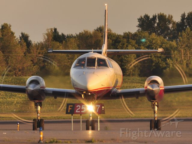 Fairchild Dornier SA-227DC Metro (C-FYWG) - Turning off after landing on Rwy 07 at sunset.