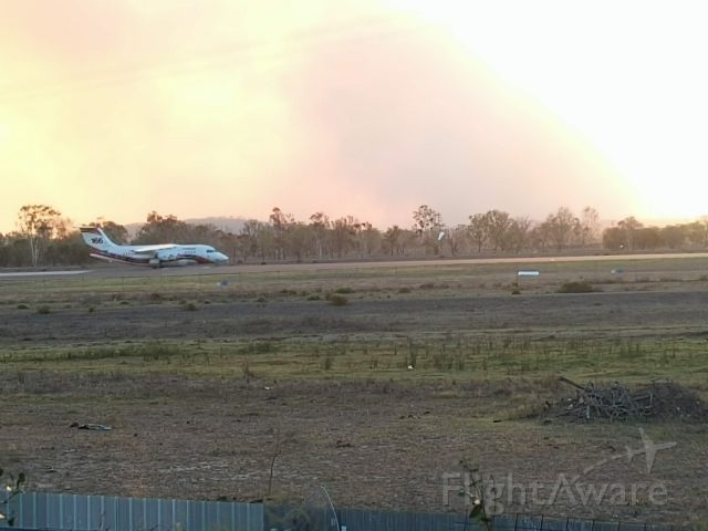 Avro Avroliner (RJ-85) (BMBR166) - BMBR166 taking off on runway 33 at Rockhampton during the bushfire emergency