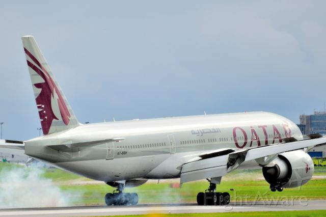 BOEING 777-200LR (A7-BBH) - Arriving from Doha.