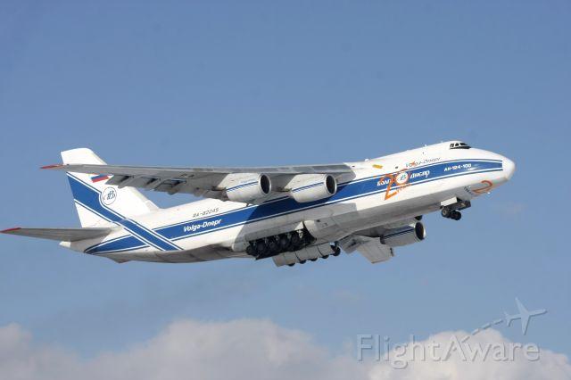 Antonov An-124 Ruslan (RNA82045) - Gear doors open for retraction on the slow climb off Runway 14 on Feb 11, 2011 as flight VDA2118 to KNUQ