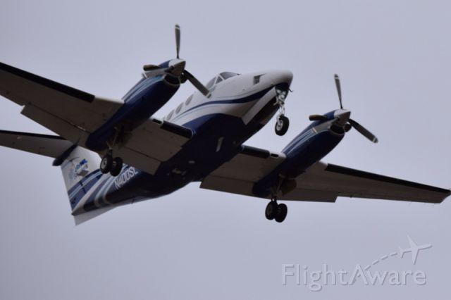 Beechcraft Super King Air 200 (N400SL) - Near the approach lights for 10R