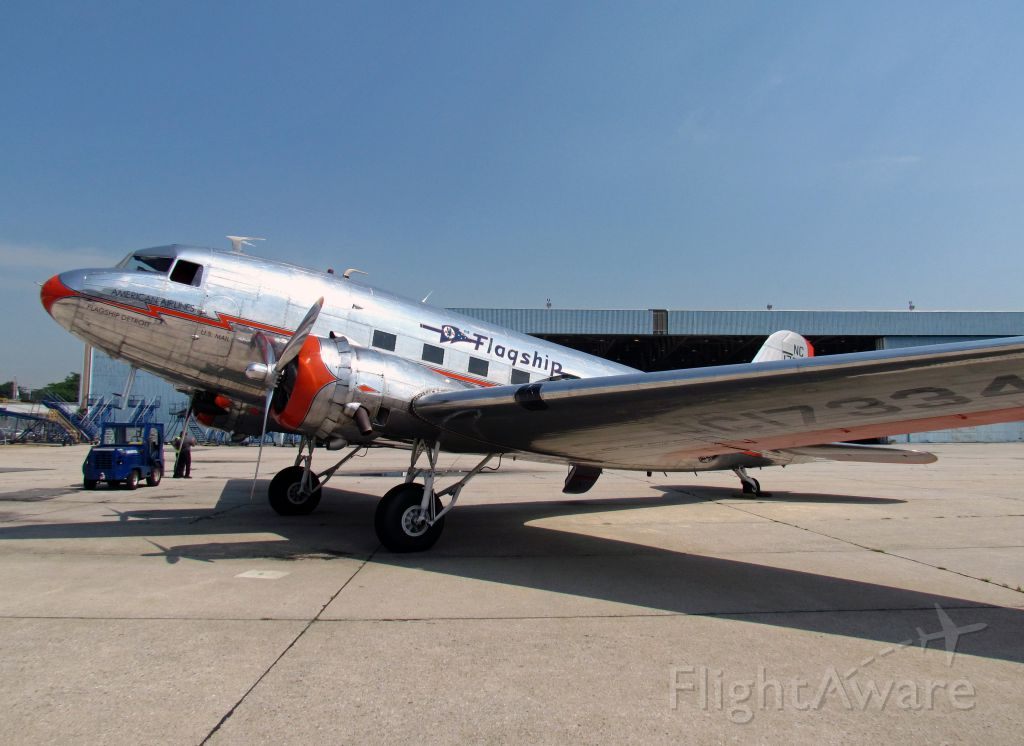 "Douglas DC-3 (NC17334) - American's ""Flagship Detroit"" paid a special visit to JFK in July. It is pictured here near AA's Hanger 10 at JFK."