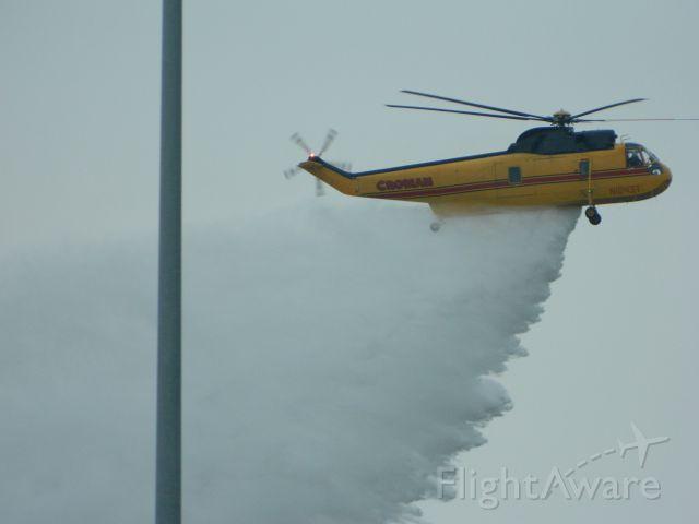 Beechcraft Bonanza (33) (N1043T) - S-61A doing a water drop demo. 1/26/2012
