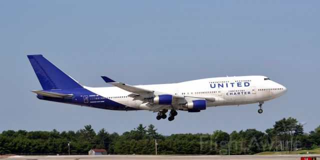 Boeing 747-400 (N194UA) - United 9981 Troop charter flight from fort Bliss TX over the numbers at Portsmouth NH