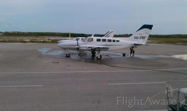 Piper Apache (VQ-TRF) - CAICOS EXPRESS CESSNA 402S GETING A WASH DOWN.