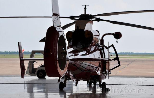 — — - MH-65C of Coast Guard Air Station Houston