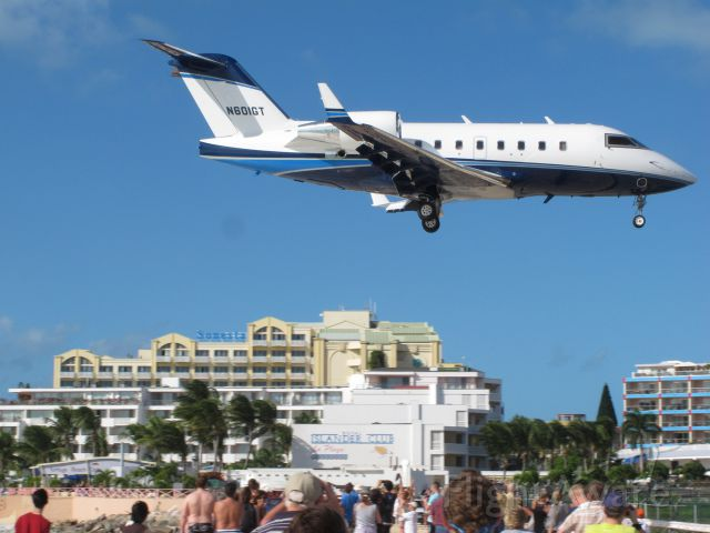 Canadair Challenger (N601GT) - Caught a fraction of a second late, but landing at Princess Juliana Airport, December 24, 2011
