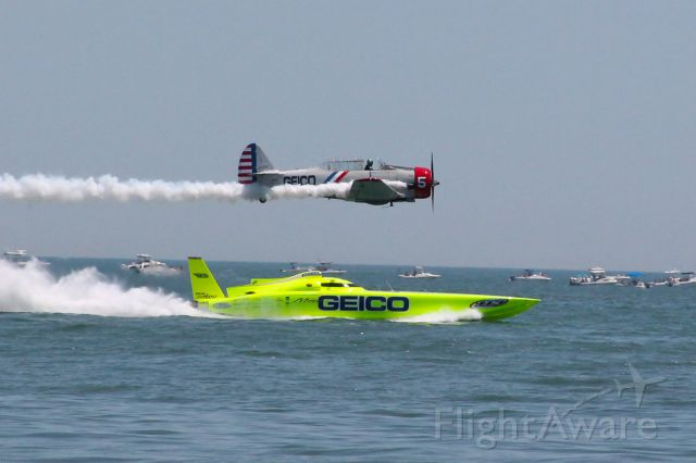 — — - From thel Ocean City Air Show in Ocean City Maryland on June 12, 2012.  This is Geico Skytyper 5 racing Miss Geico Cigar Boat.