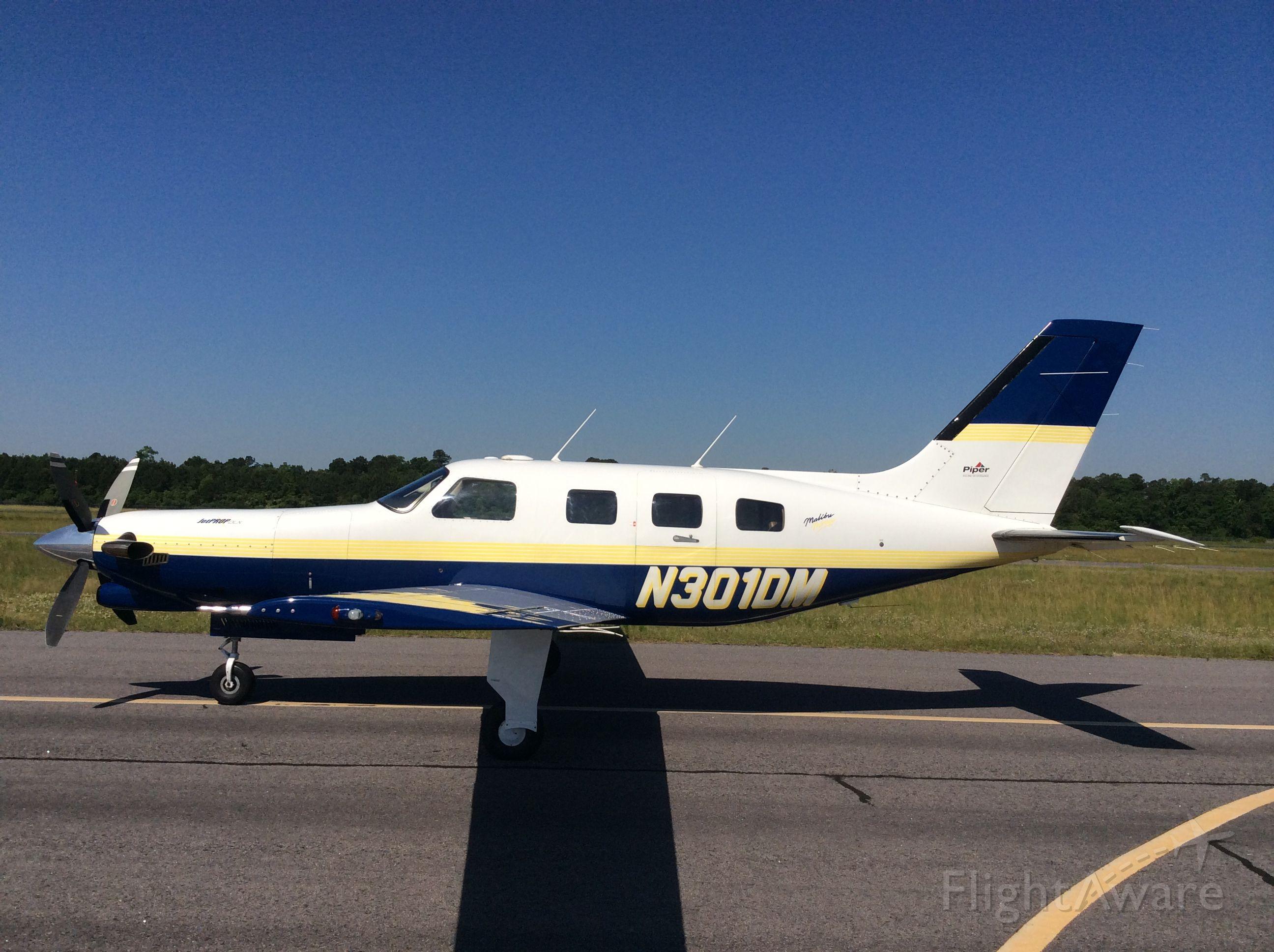 Piper Malibu Meridian (N301DM) - Left side view.