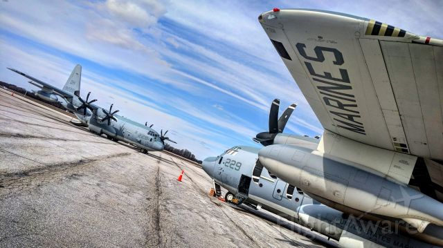 Lockheed C-130 Hercules — - A rare pair of USMC C-130Js stopped in.