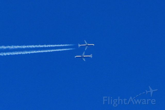 Airbus A321 — - I took this picture at just the right moment as two USAirways Airbus passed over Nashville Tennessee only a few thousand feet apart. The one making the contrail was headed east. I was using a Canon 250m zoom lens.