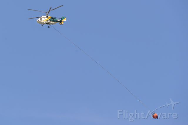 KAMOV Ka-32 (C-GURI) - VIH Helicopters Kamov Ka-32 fighting a wildfire just outside Nelson, British Columbia over the summer.