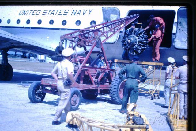 Douglas C-54 Skymaster (50-8857) - LOWERING THE ENGINE ONTO THE TROLLEY, Flinders Island 1964
