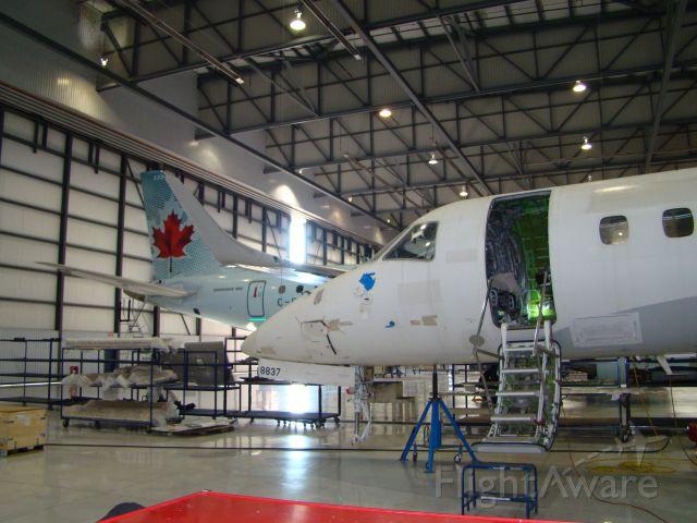 Embraer ERJ-135 — - Embraer ERJ-135 with new landing gear installed. At the Big E. The Big E is Embraer in Nashville Tn.