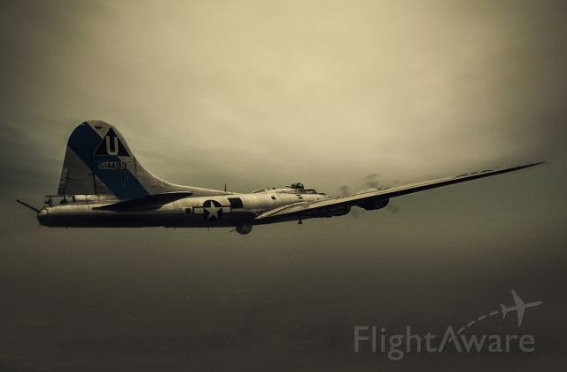 Boeing B-17 Flying Fortress (N9323Z) - Airplane was on the ramp, I just photoshopped it flying