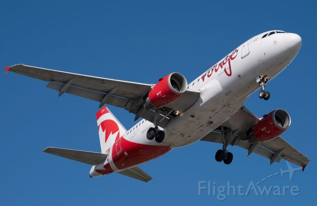 Airbus A319 (C-GKOB) - Air Canada Rouge on short final into Toronto Pearson (YYZ) on a brilliant summer afternoon.