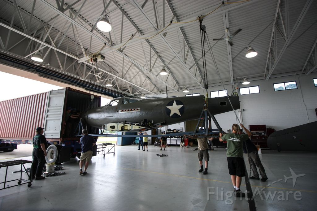 Bell Airacobra (N39FF) - The Fighter Factory and Precision Aero unload the Military Aviation Museum's Bell P-39F Airacobra (serial #41-7215) on Friday, May 17, 2019