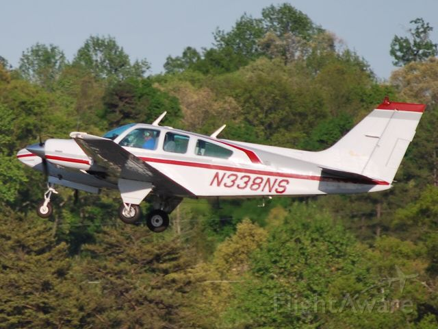 Beechcraft 55 Baron (N338NS) - Departing runway 02 - 4/11/10