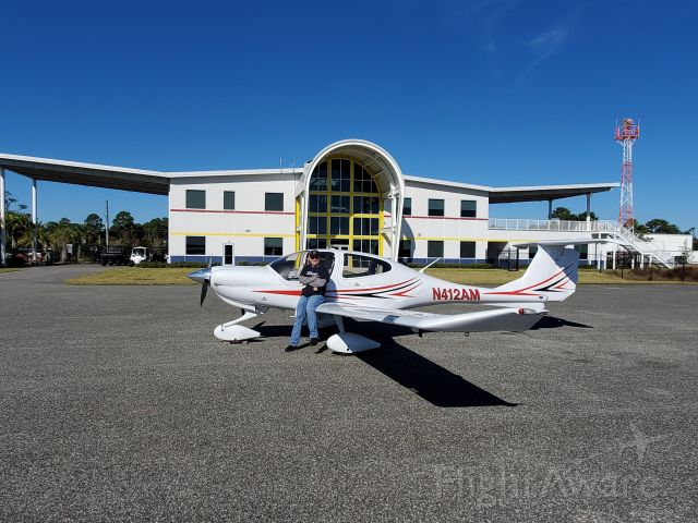 Diamond Star (N412AM) - Love this FBO. Building shaped like an airplane.