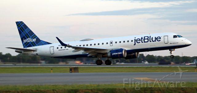 "Embraer ERJ-190 (N216JB) - Beginning its first flight of a new revenue day, jetBlue's ""Blue Getaways"" (N216JB) is just rotating from Runway 5."