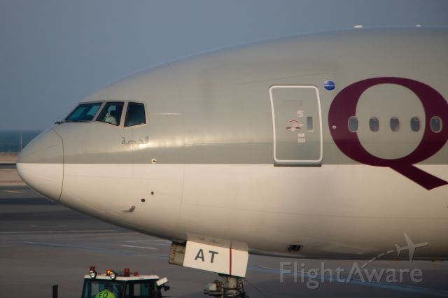 BOEING 777-300 (A7-BAT) - A7-BAT pushing back as we were arriving.