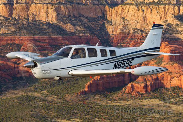 Beechcraft Bonanza (36) (N659E) - Air to air over Sedona AZ. Photo by Jay Beckman, br /T34 photo ship pilot was Tom Mitchell. G36 owner/pilot John Rippinger.
