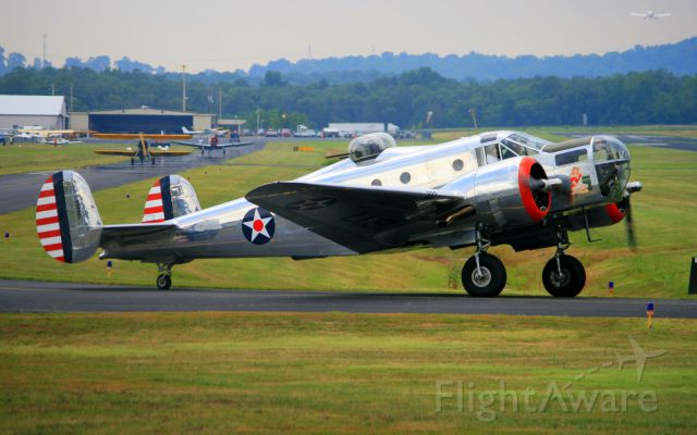 N7337C — - 1943 Beech AT-11 taxing to runway 19 after participating in a fly-in sponsored by the EAA at M54.