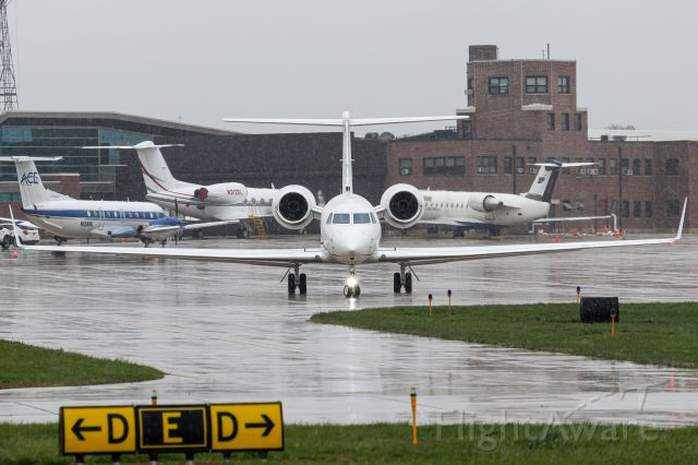 Gulfstream Aerospace Gulfstream V (N552MW) - The taxiways in the bottom of the frame show how I felt waking up and realizing it was going to snow in late April... and getting my shoes and clothes soaked taking this photo