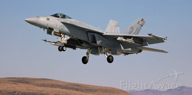 """McDonnell Douglas FA-18 Hornet (16-8917) - United States Navy McDonnell Douglas F/A-18E Super Bug (168917)<br />VFA-192 (Strike Fighter Squadron One Ninety Two) """"Golden Dragons""""<br />Home Port: Naval Air Station Lemoore (NAS Lemoore), Lemoore, CA<br />Navy Lt Catherine """"Barb"""" Drake pilots her F/A-18E Super Hornet down to KNFL's 31L after participating in a late afternoon training exercise."""