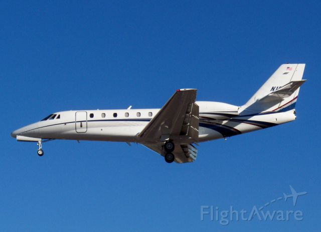 """Cessna Citation Sovereign (N18WE) - """"Freight Line 18"""" over the fence for 27R after 5.5 hour flight from KGSO."""