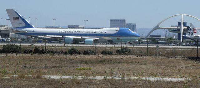 Boeing 747-200 (29000) - From a distance...  Tail #29000 about to commence take off roll from LAX