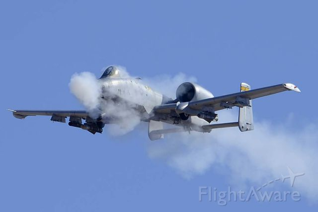 Fairchild-Republic Thunderbolt 2 (82-0663) - A-10C Warthog of the 357th Fighter Squadron Dragons based at Davis-Monthan Air Force Basefires its GAU-8 30mm cannon at a target on the Goldwater Bombing Range.
