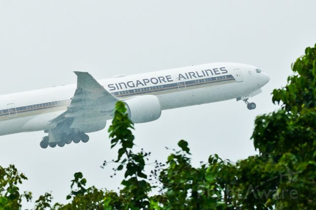 BOEING 777-300ER (9V-SWS) - 777-300ER taking off from Singapore Changi during a rainy afternoon