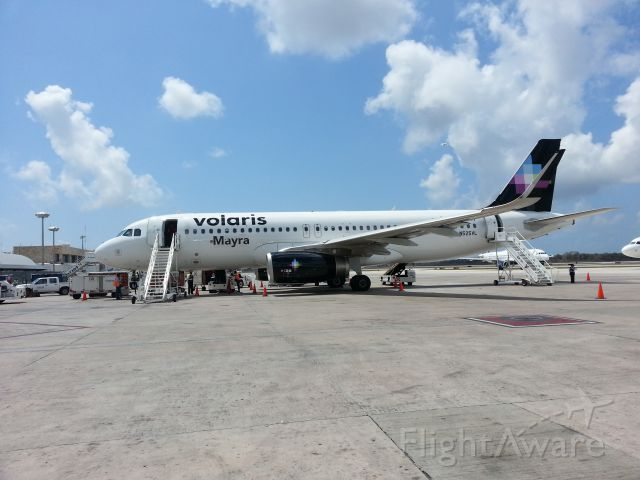 Airbus A320 (N525VL) - Taken with cellphone from ramp at Cancun, Mexico.