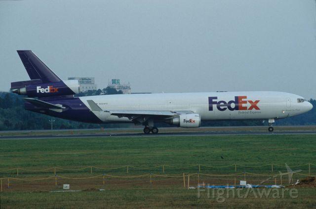 Boeing MD-11 (N604FE) - Departure at Narita Intl Airport Rwy16R on 1996/10/19