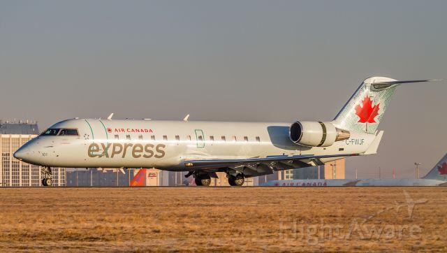 Canadair Regional Jet CRJ-100 (C-FWJF) - Sunrise at YYZ… runway 24L