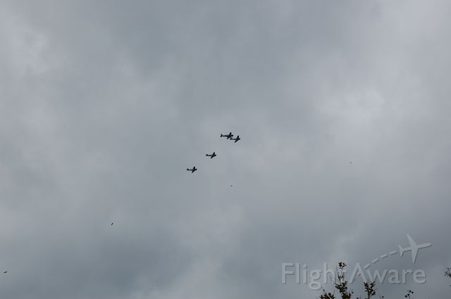 — — - Tora Tora Tora planes practicing at KCXO. Conroe Tx Flying over my house. Never seen The Buzzards fly with them! :)