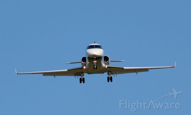 IAI Gulfstream G150 (N722SW) - A Gulfstream G-150 approaches runway 25 in a slight crosswind.