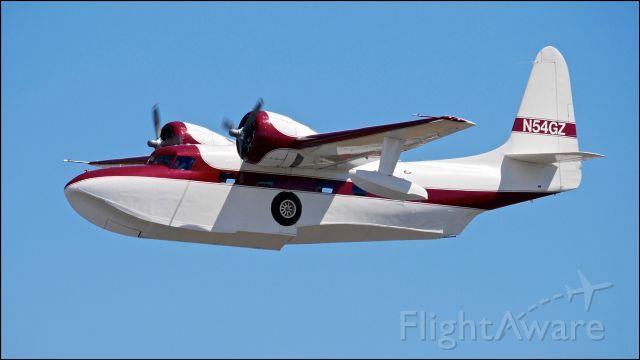 Grumman G-73 Mallard (N54GZ) - SkyFair 7.21.18: #N54GZ - Grumman G-73 Mallard (Ser #J54) (Mfr 1950) makes a low pass over Rwy 34L.