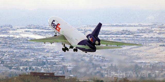 "McDonnell Douglas DC-10 (N313FE) - Flashback to Jan, 2017 ~~<br />Fed Ex's ""Bilal"" climbing thru a light snowfall as it departs for Memphis."