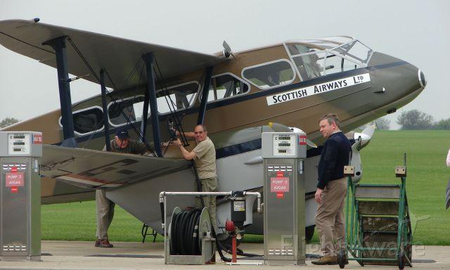 De Havilland Dragon Rapide (G-AGJG) - De Havilland DH89A dragon Rapide at the fuel pumps at Sywell UK