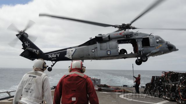 """Sikorsky S-70 (16-5776) - USN Sikorsky MH-60S """"Sea Hawk,"""" assigned to Helicopter Sea Combat Squadron 23, conducting vertical replenishment operations between the USNS SHASTA (T-AE 33) and USS CARL VINSON (CVN 70)."""
