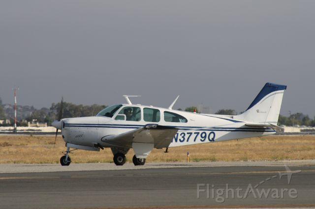 Beechcraft Bonanza (33) (N3779Q) - Taxiing for takeoff at John Wayne Airport, July 17 2018.