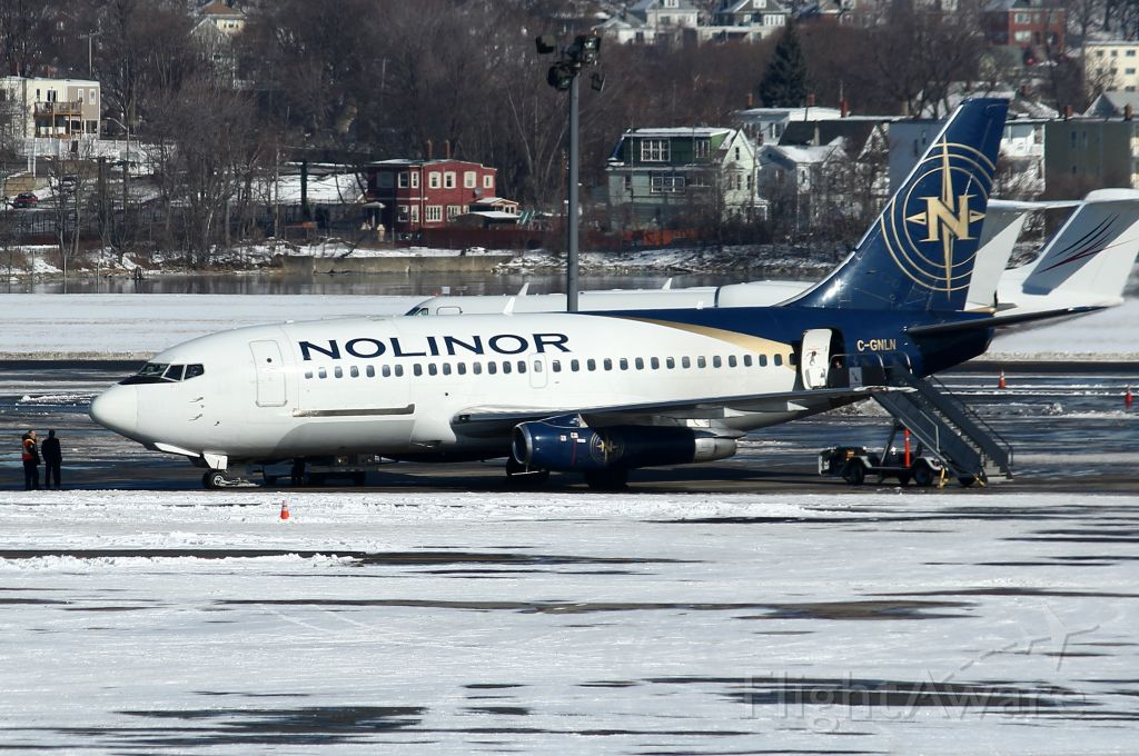 Boeing 737-200 (C-GNLN) - A rare visitor parked in North Cargo. Flown in from Ottawa to pick up a Boston Orchestra.