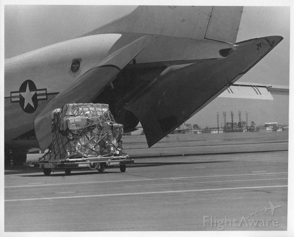 Lockheed C-141 Starlifter — - Loading cargo at Yokota Air Base, Japan (near Tokyo). This photo was taken in 1973.