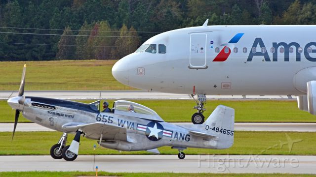 """Airbus A320 (N653AW) - American Airlines A320 (N653AW) taxiing next to the Collings Foundation TF-51D """"Toulouse Nuts"""" on 10/21/2017 at 5:23 PM."""