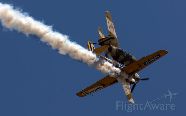 — — - The two planes were passing very close at an air show.